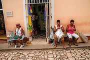 Cuba, Trinidad. women sit in the street