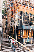 Bamboo scaffolding being installed for building rennovation