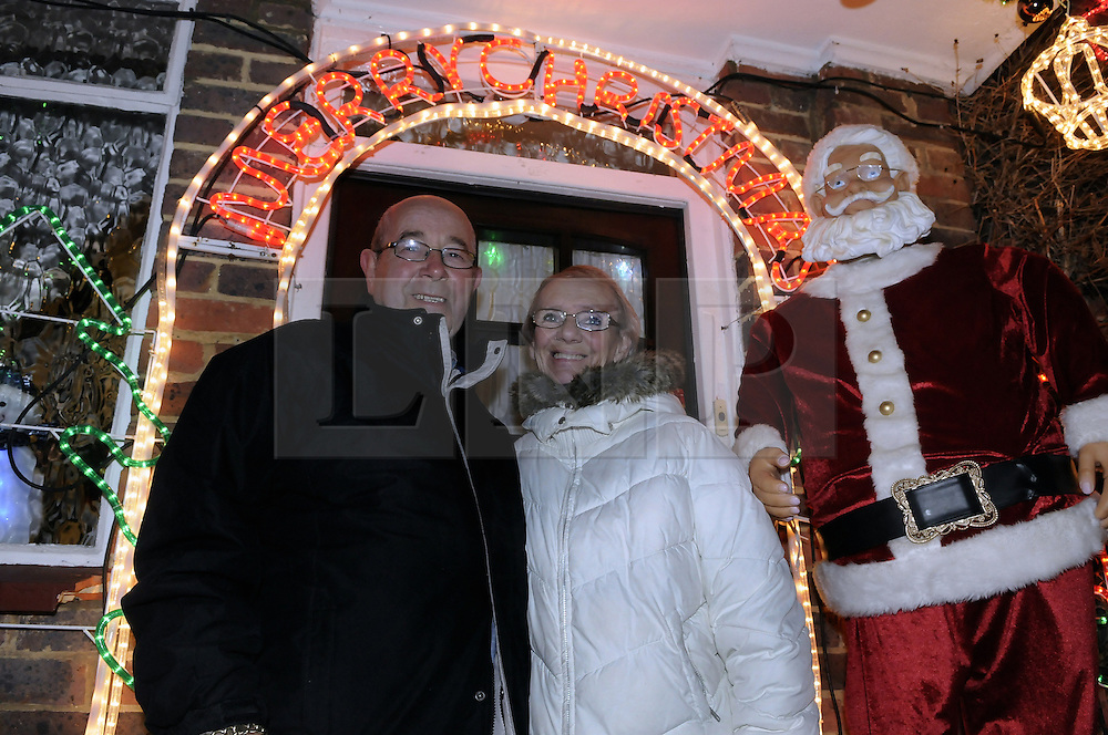 © Licensed to London News Pictures. 05/12/2012.Terry and Pat Batney from Mickleham Road, St Pauls Cray,Orpington in Kent have spent thousands of pounds on Christmas lights over the years so that their grandchildren and local children can enjoy and celebrate Christmas..Photo credit : Grant Falvey/LNP