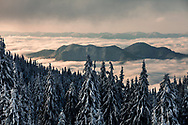 Mountain ridge above the cover of clouds
