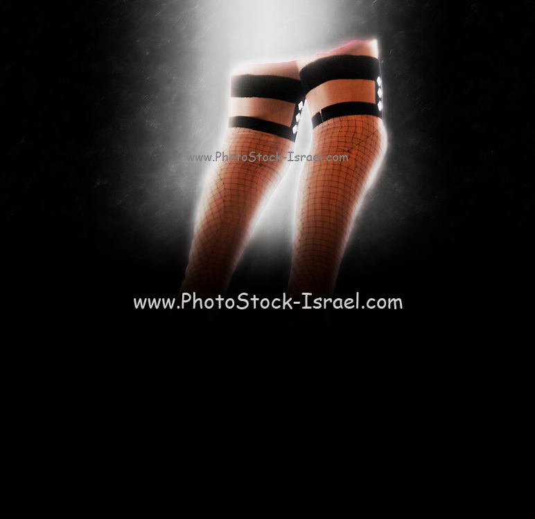 Digitally enhanced image of plastic legs in fishnet stockings
