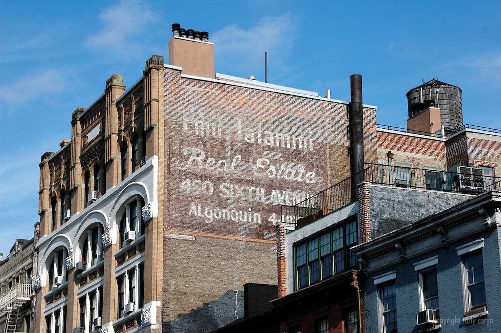 6th Avenue ghost painted advertisement