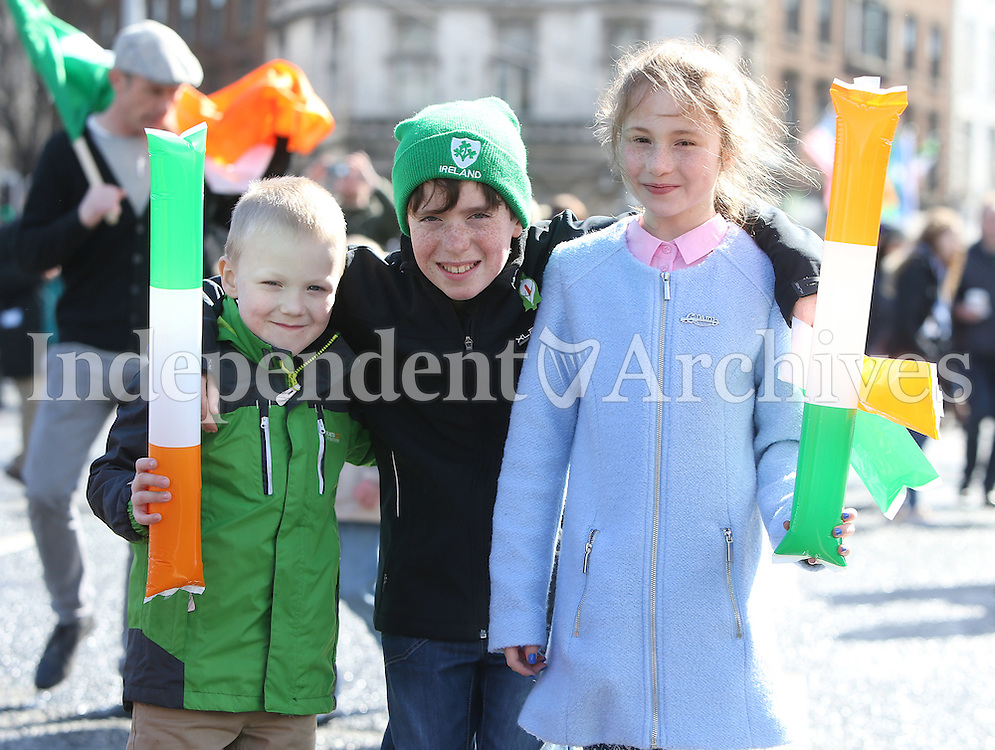 Phelim Og Seery, 6, from Clondalkin, Turlough McLoughlin Martin, 12, from Leitrim and Eabha Seery, 9, from Clondalkin, they are great great grandchildren of Vincent Poole who was a member of the Irish Citizen Army pictured during the centenary Easter Rising Parade at O'Connell Street in Dublin. Picture credit; Damien Eagers 27/3/2016