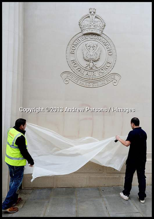 The Clean-up operation begins at war memorials defaced with Islamic slogans in London. The word 'Islam' is removed which was daubed on a memorials to members of RAF Bomber Command after a spate of ugly attacks in the wake of soldier Lee Rigby's murder..Tuesday, 28th May 2013.Picture by Andrew Parsons / i-Images