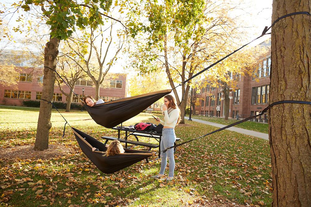 Location; Outside; UWL UW-L UW-La Crosse University of Wisconsin-La Crosse; People; Student Students; Woman Women; Buildings; Morris Hall; Hammock; Fall