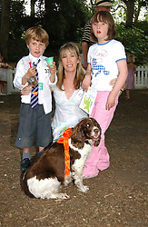 CAROLINE ARMSTRONG-JONES, her children ROBERT and INDIA and their dog Daisy at the Macmillan Cancer Support Dog Day held in the gardens of the Royal Hospital, Chelsea, London on 4th July 2006.<br /><br />NON EXCLUSIVE - WORLD RIGHTS