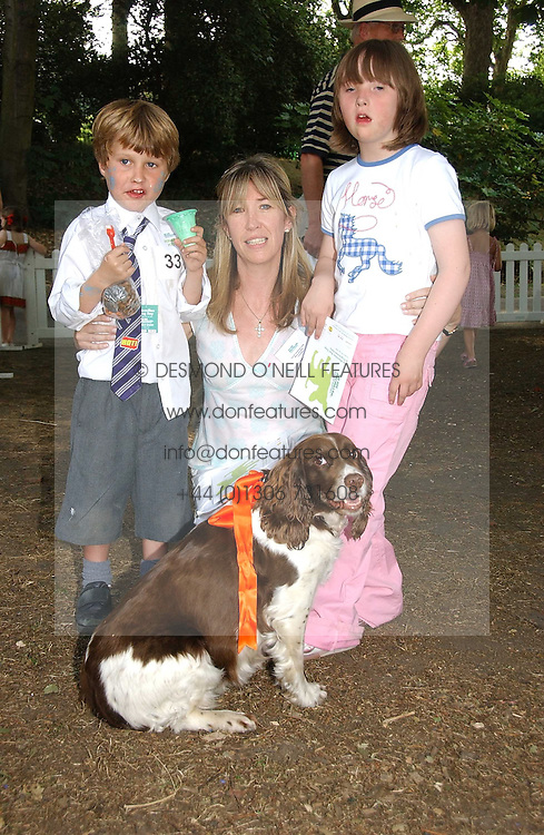 CAROLINE ARMSTRONG-JONES, her children ROBERT and INDIA and their dog Daisy at the Macmillan Cancer Support Dog Day held in the gardens of the Royal Hospital, Chelsea, London on 4th July 2006.<br />