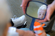 Patient Jeannette Schmauder, 80, sees her reflection in the mirror as Chaplain Blaik Westhoff (cq) holds that mirror after asking about God's most important creation during Spirit Alive, a religious service for people with dementia that incorporates Montessori principles Wednesday, June 28, 2017 at Meadow Glen Personal Care in Richlandtown, Pennsylvania. (WILLIAM THOMAS CAIN / For The Philadelphia Inquirer)