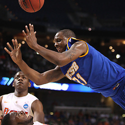 Mar 17, 2011; Tampa, FL, USA; UC Santa Barbara Gauchos forward James Nunnally (21) collides with Florida Gators forward/center Patric Young (4) during second half of the second round of the 2011 NCAA men's basketball tournament at the St. Pete Times Forum. Florida defeated UCSB 79-51.  Mandatory Credit: Derick E. Hingle