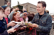 Shane Filan, of westlife signs autographs for his adoring fans at the town Hall, Sligo, where Westlife were given fredom of Sligo. Photo: James Connolly/GreenGraph