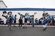 Los Angeles Rams tight ends Kendall Blanton (86) and Keenan Brown (48) paint mural of defensive tackle  Aaron Donald  (99) during community improvement project at Belvedere Elementary School to upgrade play and social spaces around the school by building a new playground structure, painting murals and basketball backboards and landscaping., Friday, June 14, 2019, in Los Angeles, Calif. (Ed Ruvalcaba/Image of Sport)