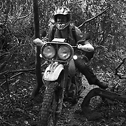 Digby Greenhalgh navigates his way through a particularly narrow stretch of the Ho Chi Minh Trail in Laos. Digby is a professional motorbike tour guide based in Hanoi, Vietnam.
