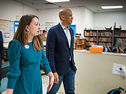 01 NOVEMBER 2019 - DES MOINES, IOWA: JILL APPLEGATE, left, and US Senator CORY BOOKER (D-NJ) walk into Conmigo Early Education Center. Sen. Booker visited Conmigo Early Education Center, a bilingual education center for children ages 1-5. He talked to staff about the needs of children. Booker is running to be the Democratic nominee for president and spoke later in the evening at the Liberty and Justice Celebration.          PHOTO BY JACK KURTZ