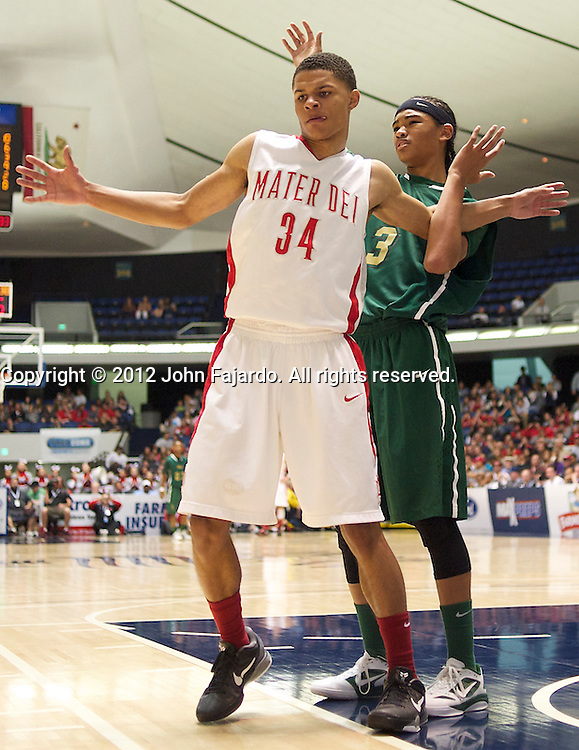 Poly's Joshua Munzon(3) and Mater Dei's Jordan Strawberry(34) get tangled before play starts in the CIF Southern Section Boys Basketball Championship at the Anaheim Convention Center, Sat., March 3, 2012.