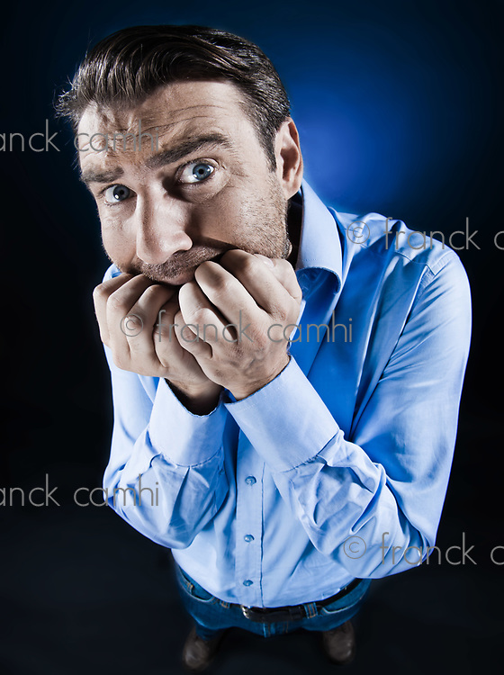 caucasian man scared anxious fear unshaven  isolated studio on black background