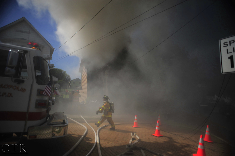 A house fire burns along Locust Street in Coraopolis, Pa. June 3, 2011. While everyone inside was safely evacuated from the burning building, the house was a total loss.