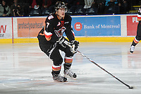 KELOWNA, CANADA, FEBRUARY 17: Alex Roach #7 of the Calgary Hitmen skates with the puck at the Kelowna Rockets on February 17, 2012 at Prospera Place in Kelowna, British Columbia, Canada (Photo by Marissa Baecker/Shoot the Breeze) *** Local Caption ***
