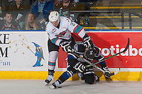 KELOWNA, CANADA - APRIL 12: Calvin Thurkauf #27 of Kelowna Rockets checks Joe Hicketts #2 of Victoria Royals at the boards during second period on April 12, 2016 at Prospera Place in Kelowna, British Columbia, Canada.  (Photo by Marissa Baecker/Shoot the Breeze)  *** Local Caption *** Calvin Thurkauf; Joe Hicketts;