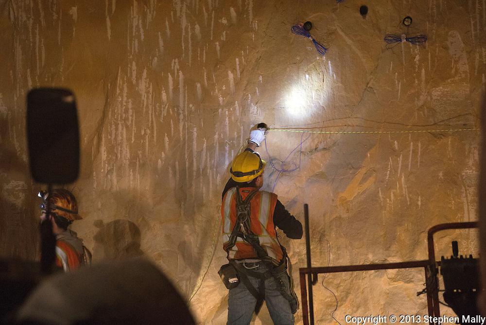 Workers prepare explosives for a blast inside the mine at Pattison Sand Company in Garnavillo, Iowa on June 5, 2013.