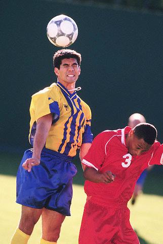 Grimacing soccer players --- Image by © Jim Cummins/CORBIS