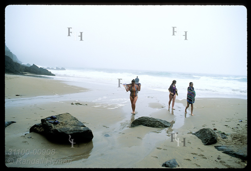 Three girls return from wading in rough waters of beach near Slea Head; Dingle Peninsula. Ireland