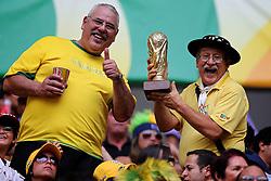 """O torcedor brasileiro conhecido como """"Gaúcho da Copa"""" é visto na arquibancada durante a cerimônia de abertura da Copa das Confederações, realizada no Estádio Nacional Mané Garrincha, em Brasília, antes da partida entre Brasil e Japão. FOTO: Jefferson Bernardes/Preview.com"""