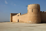 Crenellated ramparts of the Sheikh Salman bin Ahmed Al-Fateh Fort, or Riffa Fort, built in the 17th century and rebuilt as the ruling Al Khalifa family home in 1812, at Riffa, Bahrain. The fort is square with 2 circular and 2 rectangular towers at its corners, and 3 courtyards. It was restored in the 20th century and is now a tourist attraction. Picture by Manuel Cohen