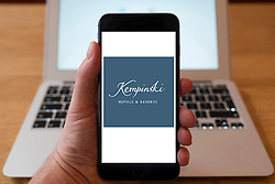 Using iPhone smartphone to display logo of Kempinski luxury hotels group
