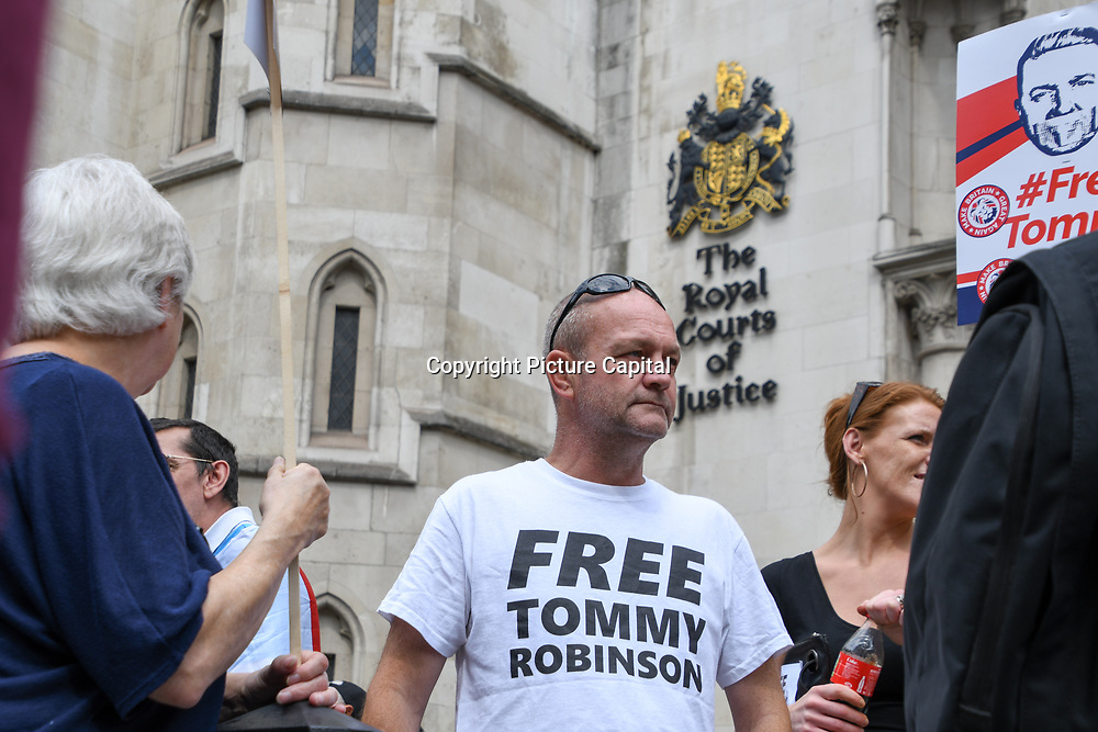 Tommy Robinson is a formal far-rights EDL leader the supporter of Tommy outside the Royal Courts of Justice to #FreeTommy. Tommy has been send to jail for 13 months of breaking contempt of court laws at the Lord Justice Leveson hearing Tommy's appeal on 18th July 2018 in London, UK.