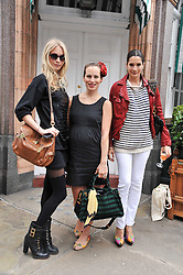 Left to right, POPPY DELEVINGNE, CHARLOTTE DELLAL and ASTRID MUNOZ at a lunch to celebrate the the Lulu & Co Autumn/Winter 2011 collection held at Harry's Bar, 26 South Audley Street, London W1 on 21st June 2011.