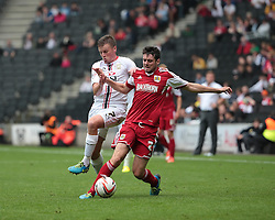 Bristol City's Brendan Moloney is challenged by Milton Keynes Dons' Stephen Gleeson  - Photo mandatory by-line: Nigel Pitts-Drake/JMP - Tel: Mobile: 07966 386802 24/08/2013 - SPORT - FOOTBALL - Stadium MK - Milton Keynes - Milton Keynes Dons V Bristol City - Sky Bet League One