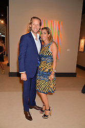 JAKE & SAMIRA PARKINSON-SMITH at the Masterpiece Marie Curie Party supported by Jeager-LeCoultre held at the South Grounds of The Royal Hospital Chelsea, London on 30th June 2014.
