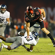 18 November 2017:  The San Diego State football team hosts Nevada Saturday night. San Diego State Aztecs tight end Kahale Warring (87) catches a pass and leaps over Nevada Wolf Pack defensive back Brandon Brooks (13) for a first down in the second quarter. The Aztecs lead 21-14 at the half. <br /> www.sdsuaztecphotos.com