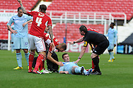 Coventry's John Fleck (on ground) is left dazed after collision with Swindon's Nathan Thompson and has to leave on a stretcher. . NPower league one, Swindon Town v Coventry city at the County Ground in Swindon on Saturday 13th October 2012.  pic by  Andrew Orchard, Andrew Orchard sports photography,