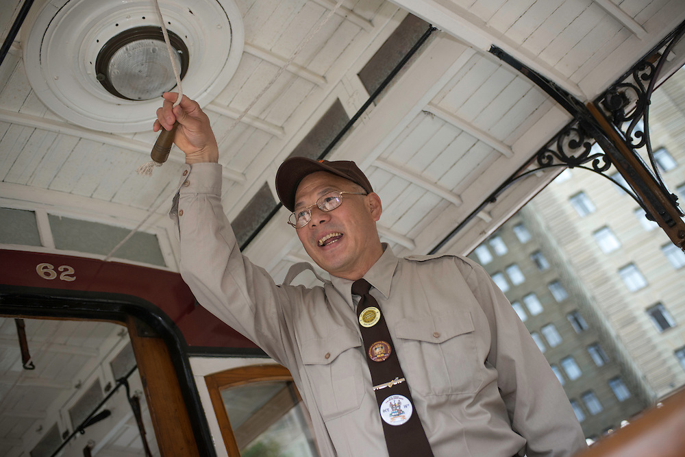 Joseph Sue practices on Cable Car 62's bell before the 50th Cable Car Bell Ringing Competition in San Francisco's Union Square | July 11, 2013