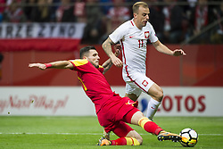 October 8, 2017 - Warsaw, Poland - Kamil Grosicki of Poland and Emrah Klimenta of Montenegro during the FIFA World Cup 2018 Qualifying Round Group E match between Poland and Montenegro at National Stadium in Warsaw, Poland on October 8, 2017  (Credit Image: © Andrew Surma/NurPhoto via ZUMA Press)