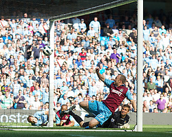 MANCHESTER, ENGLAND - Sunday, May 1, 2011: West Ham United's Lars Jacobsen looks on as he scores an own goal during the Premiership match against Manchester City at the City of Manchester Stadium. (Photo by David Tickle/Propaganda)