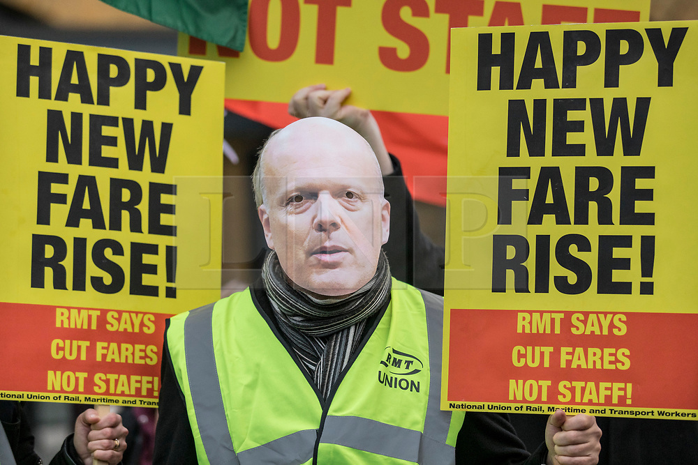 © Licensed to London News Pictures. 02/01/2019. London, UK. A protester wearing a Chris Grayling mask at King's Cross as passengers begin a 'national day of action' over 3. 1% fare increases. Photo credit: Rob Pinney/LNP