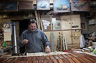 Lampedusa, Italia - Franco Tuccio, artigiano lampedusano, al lavoro nella sua bottega a Lampedusa.<br /> Ph. Roberto Salomone