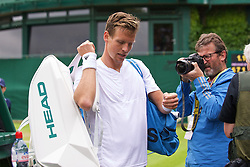 LONDON, ENGLAND - Wednesday, June 29, 2016: Tomas Berdych (CZE) in a rush to get off the court due to the rain after winning his match point during the Gentlemen's Singles 1st Round match on day three of the Wimbledon Lawn Tennis Championships at the All England Lawn Tennis and Croquet Club. (Pic by Kirsten Holst/Propaganda)