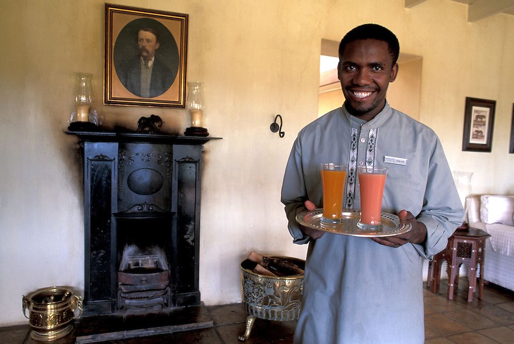 Servant with Fruit Juices,Main House, Gorah Elephant Camp Private Lodge, Addo Elephant National Park, Eastern Cape, South Africa
