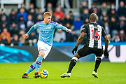 Kevin De Bruyne (#17) of Manchester City takes on Jetro Willems (#15) of Newcastle United during the Premier League match between Newcastle United and Manchester City at St. James's Park, Newcastle, England on 30 November 2019.