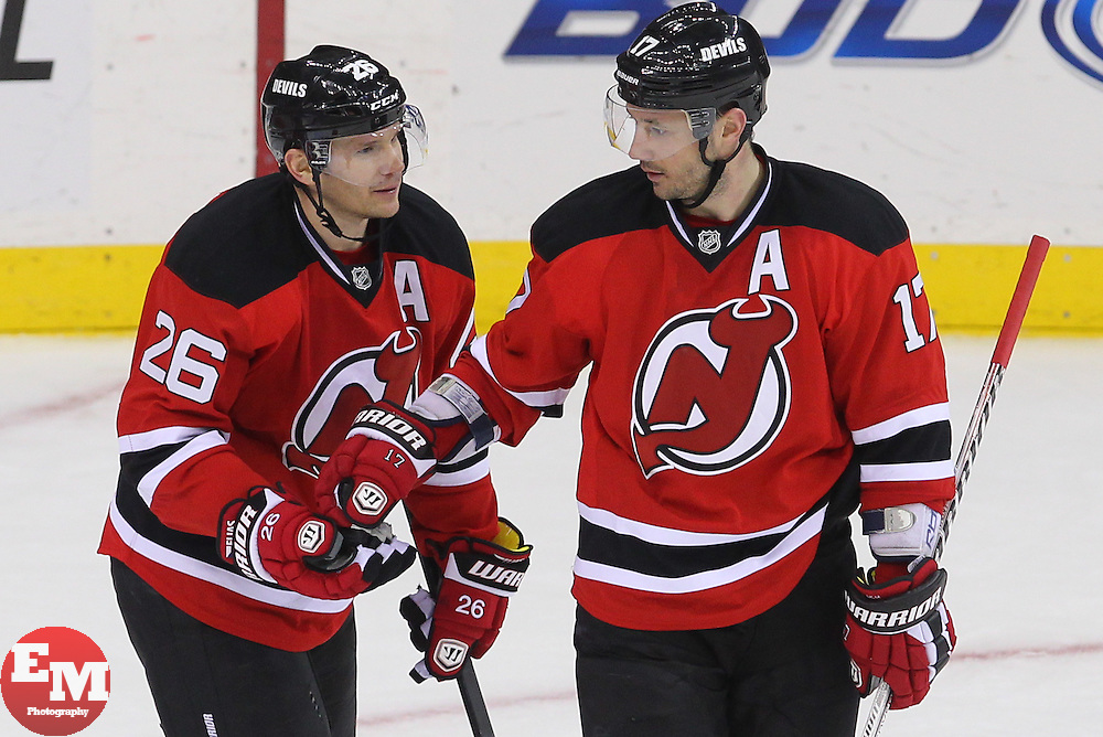 Feb 7, 2013; Newark, NJ, USA; New Jersey Devils left wing Patrik Elias (26) and New Jersey Devils right wing Ilya Kovalchuk (17) celebrate Elias' goal during the third period at the Prudential Center. The Devils defeated the Lightning 4-2.