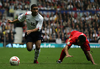 Photo: Paul Thomas.<br /> England v Andorra. European Championships 2008 Qualifying. 02/09/2006.<br /> <br /> Aaron Lennon (L) of England goes past Jose Manuel Garcia to set up Peter Crouch's second goal.