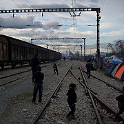 Migrant children play in the train tracks at the Greek-Macedonian border station of Idomeni, Greece. Around 13,000 migrants and refugees, mostly from the Middle East and African nations, are believe to be stranded here awaiting a chance to proceed their journey towards Germany and other northern European countries.