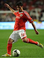 20120331: LISBON, PORTUGAL – Portuguese Liga Zon Sagres 2011/2012 - SL Benfica vs CS Braga.<br />In picture: Benfica's Joan Capdevilla, from Spain, shoots the ball.<br />PHOTO: Alvaro Isidoro/CITYFILES