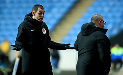 A match official gestures towards Peterborough United's Manager Steve Evans after he receives a yellow card during the match