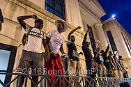 September 22, 2016 - Charlotte, NC, USA - during a third day of protests in Charlotte, North Carolina on Thursday, Sept. 22, 2016. This is the third day of violence that erupted after a police officer's fatal shooting of an African-American man Tuesday afternoon and the first full day of a declared State of Emergency by the governor. (Credit Image: © Sean Meyers/ZUMA Press)