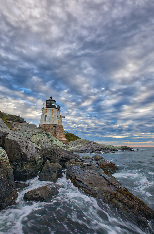 New England photography of Castle Hill Lighthouse photographed minutes before sunset. This iconic Rhode Island lighthouse is located at Narragansett Bay in Newport, RI.<br />