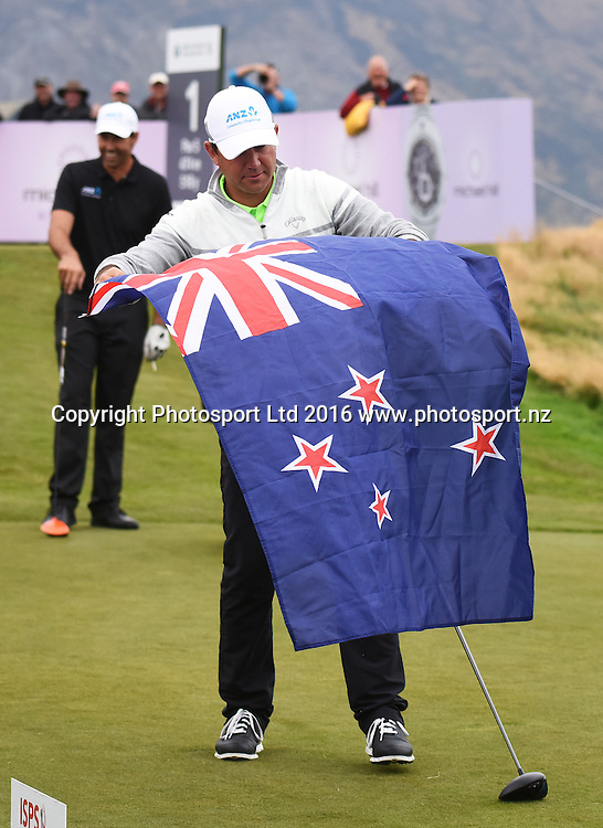 Ricky Ponting pulls out the New Zealand flag on the 1st tee during the ANZ Celebrity Challenge and Round 4 at The Hills during 2016 BMW ISPS Handa New Zealand Open. Sunday 13 March 2016. Arrowtown, New Zealand. Copyright photo: Andrew Cornaga / www.photosport.nz
